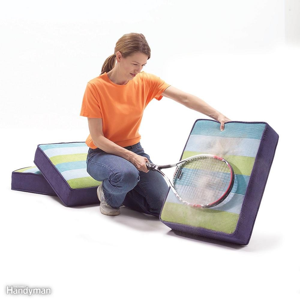 Beat The Dust out of Cushions With a Tennis Racket