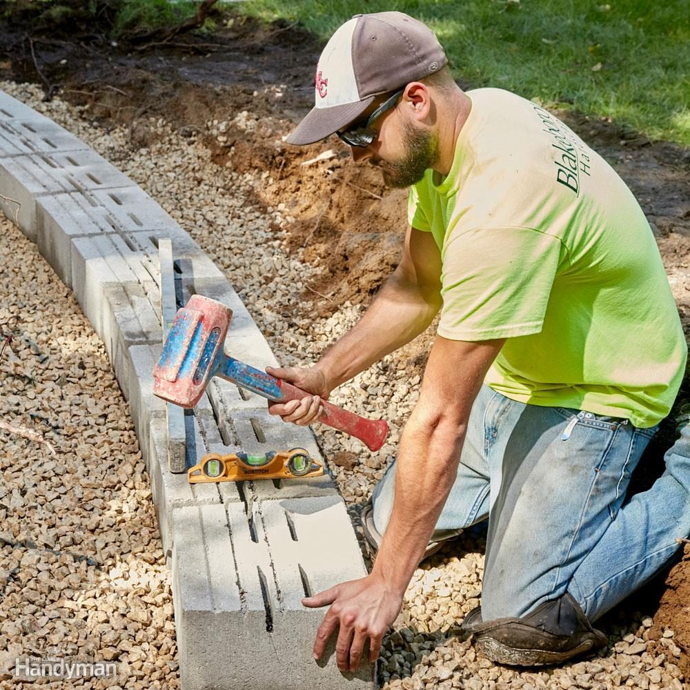 Get the first course of landscape retaining wall blocks right