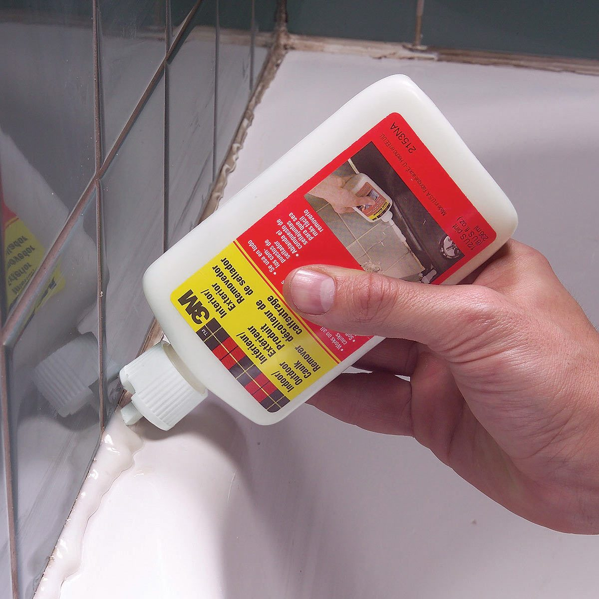 remove caulk from the tub