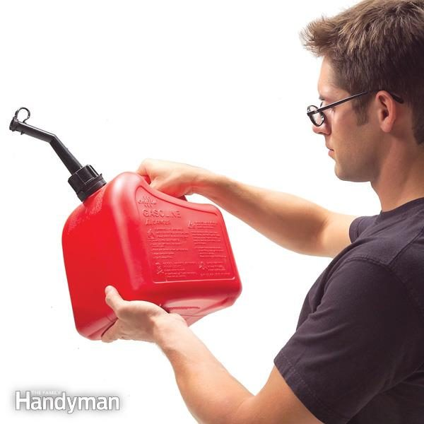 man examines a gas storage container
