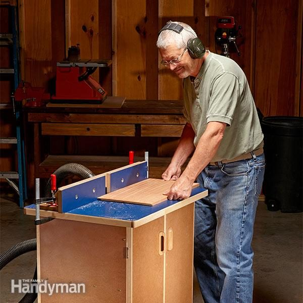 man operates a simple table router
