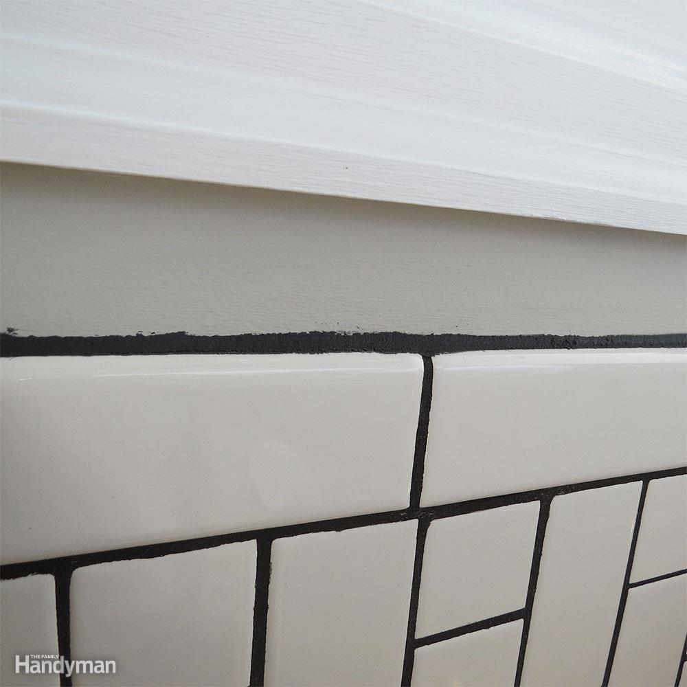 White Subway Tile Backsplash Don't: Freehand Caulk Lines