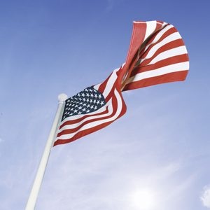 How to Install a Flagpole in Your Yard