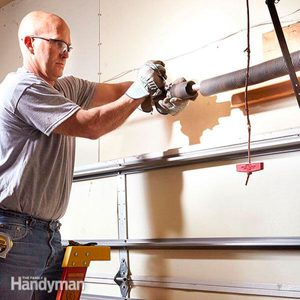 How to Repair Garage Door Springs and Cables