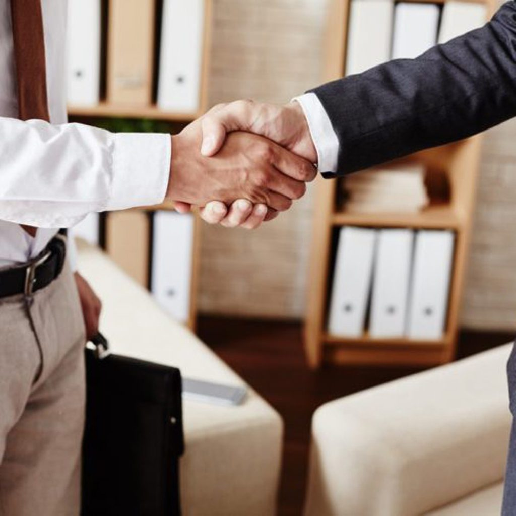 Businessmen handshaking after signing contract