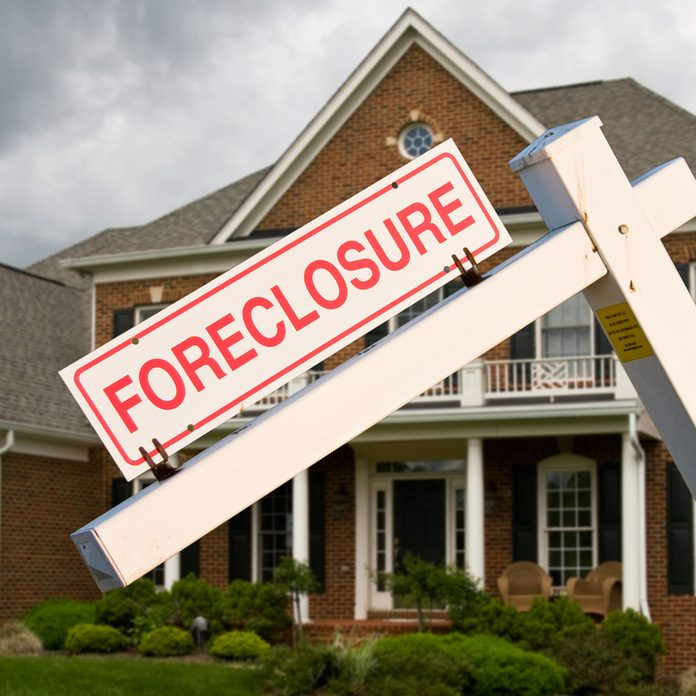 Foreclosure sign in front of a house