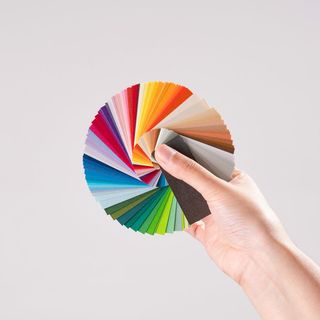 Hand Holding Color Swatches pantone color of the year