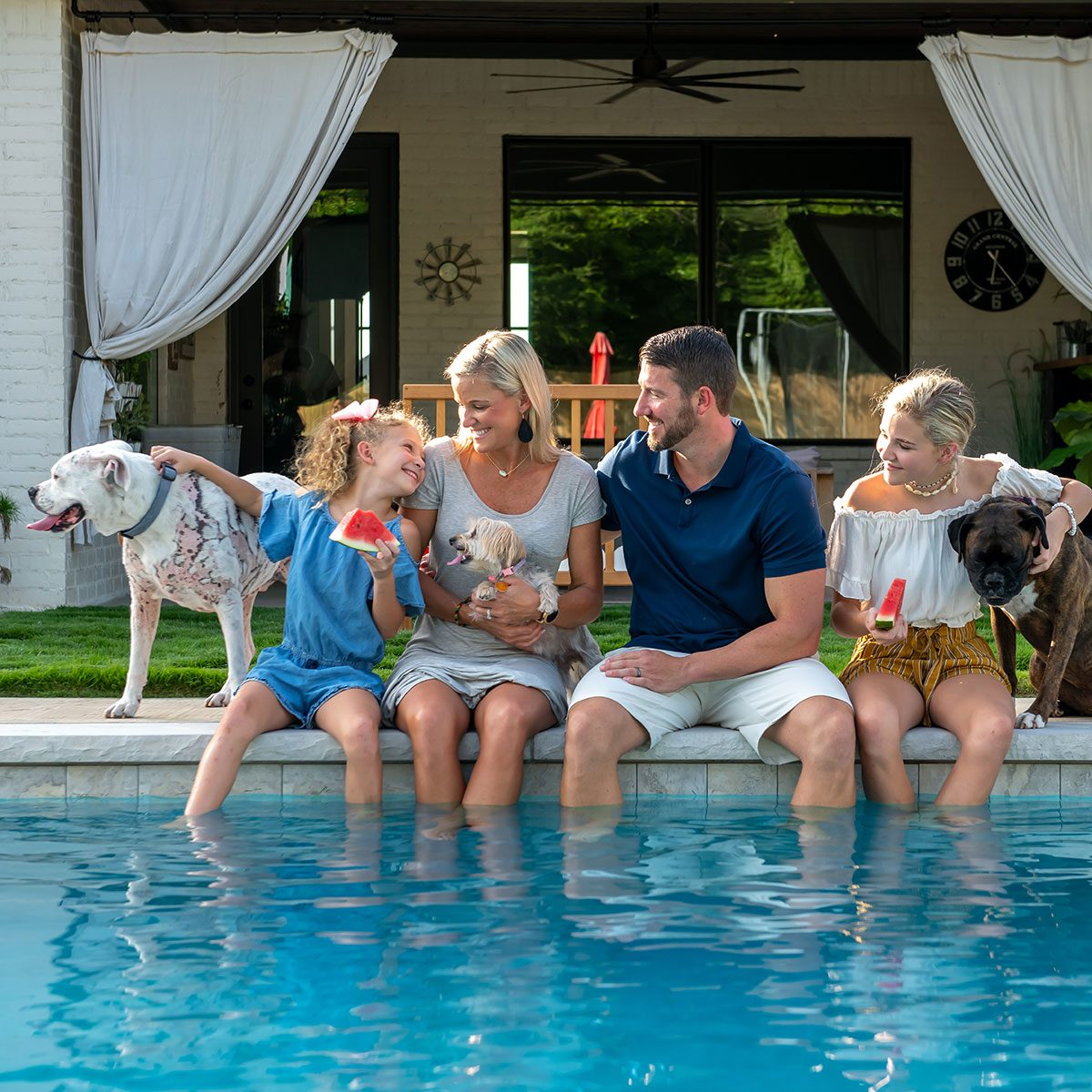 Family enjoying themselves by the pool