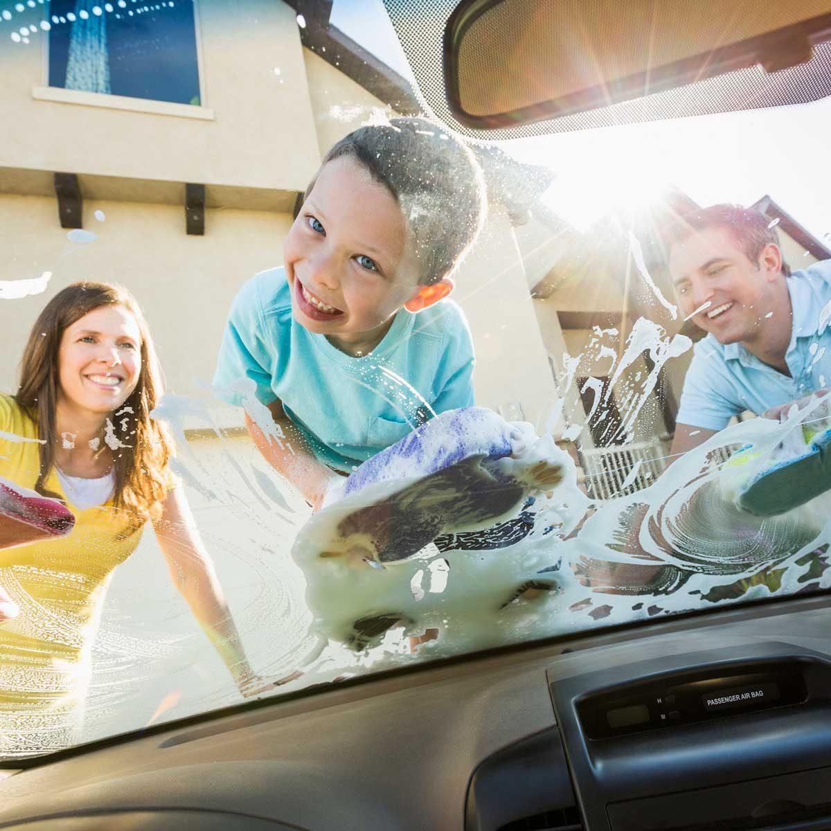 Family washing a car