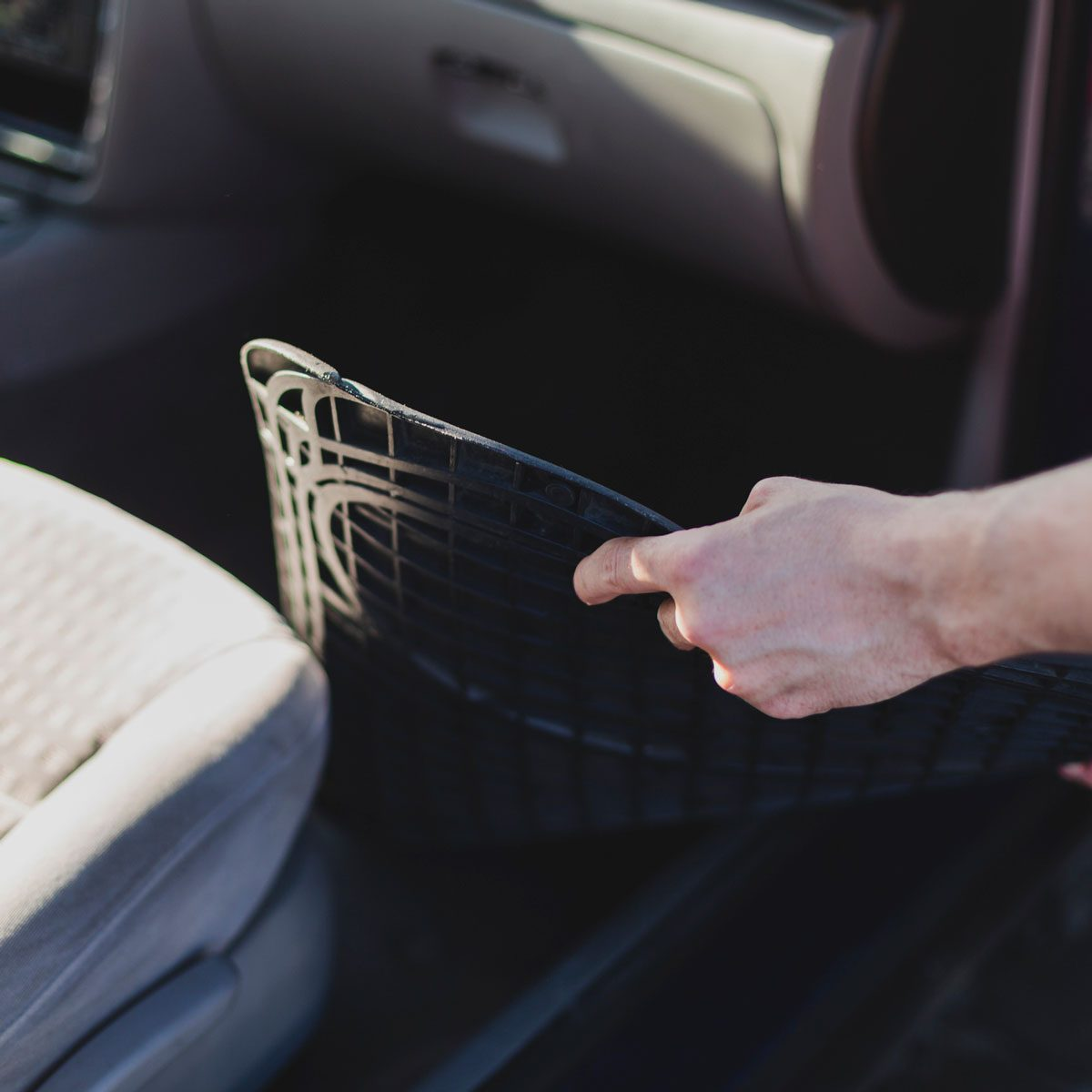 Removing floor mats from car