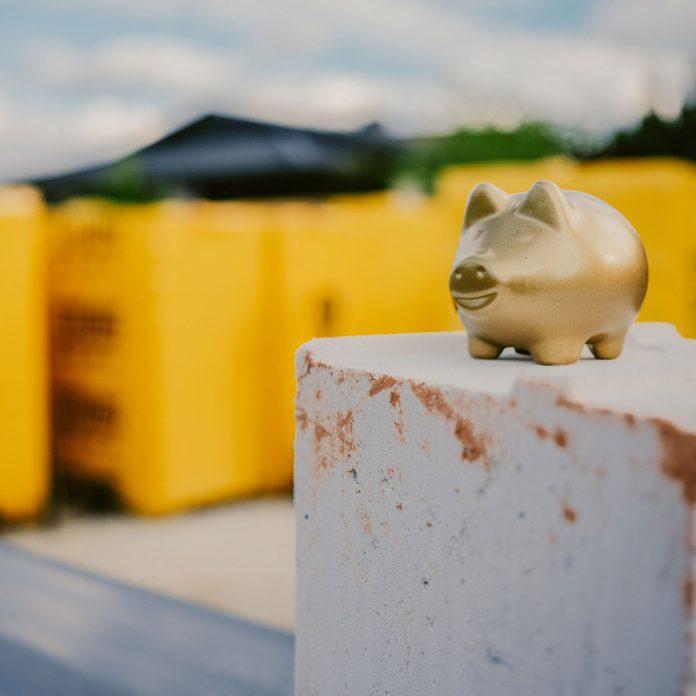 Gold piggy bank ata construction site