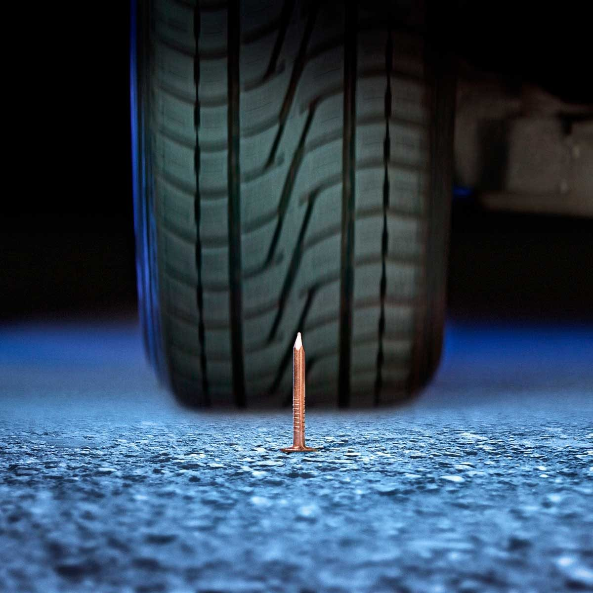 Nail in front of a tire