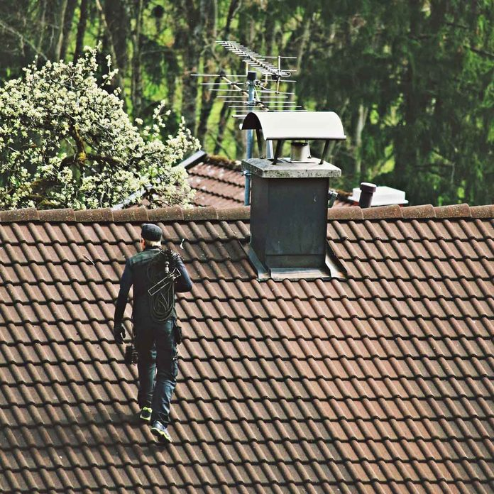 Chimney sweep on a roof