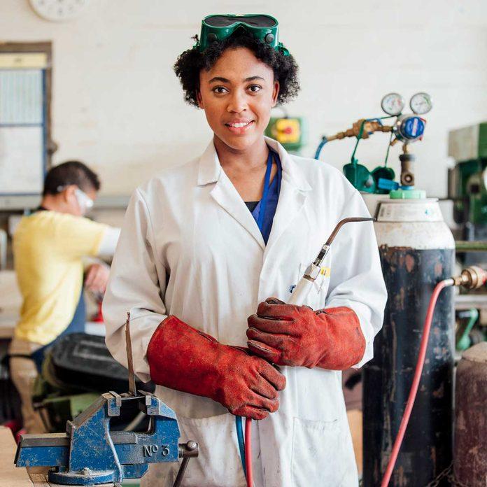 Woman in a welding classroom