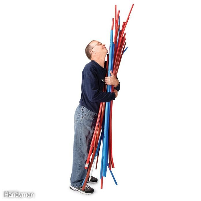 Man holding PEX piping
