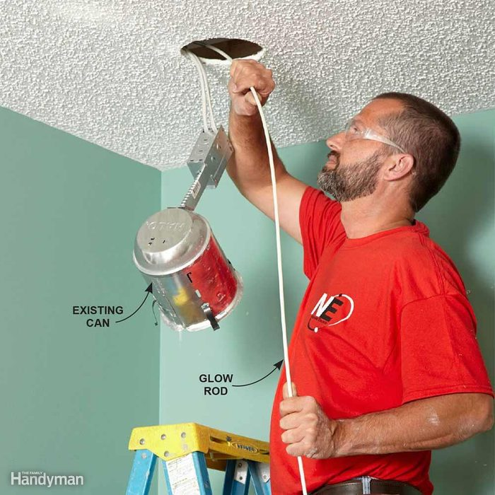 Fishing Wire Through the Holes for Recessed Lights