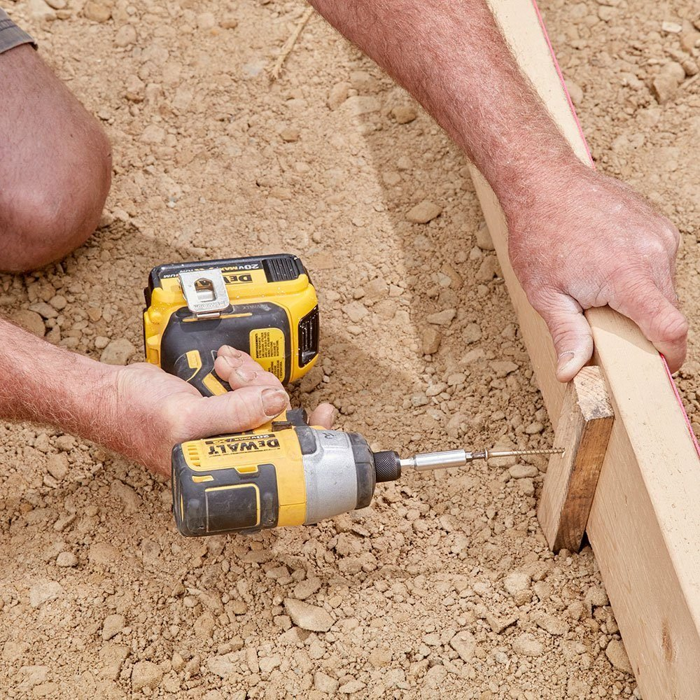 Screw form stakes into the form | Construction Pro Tips