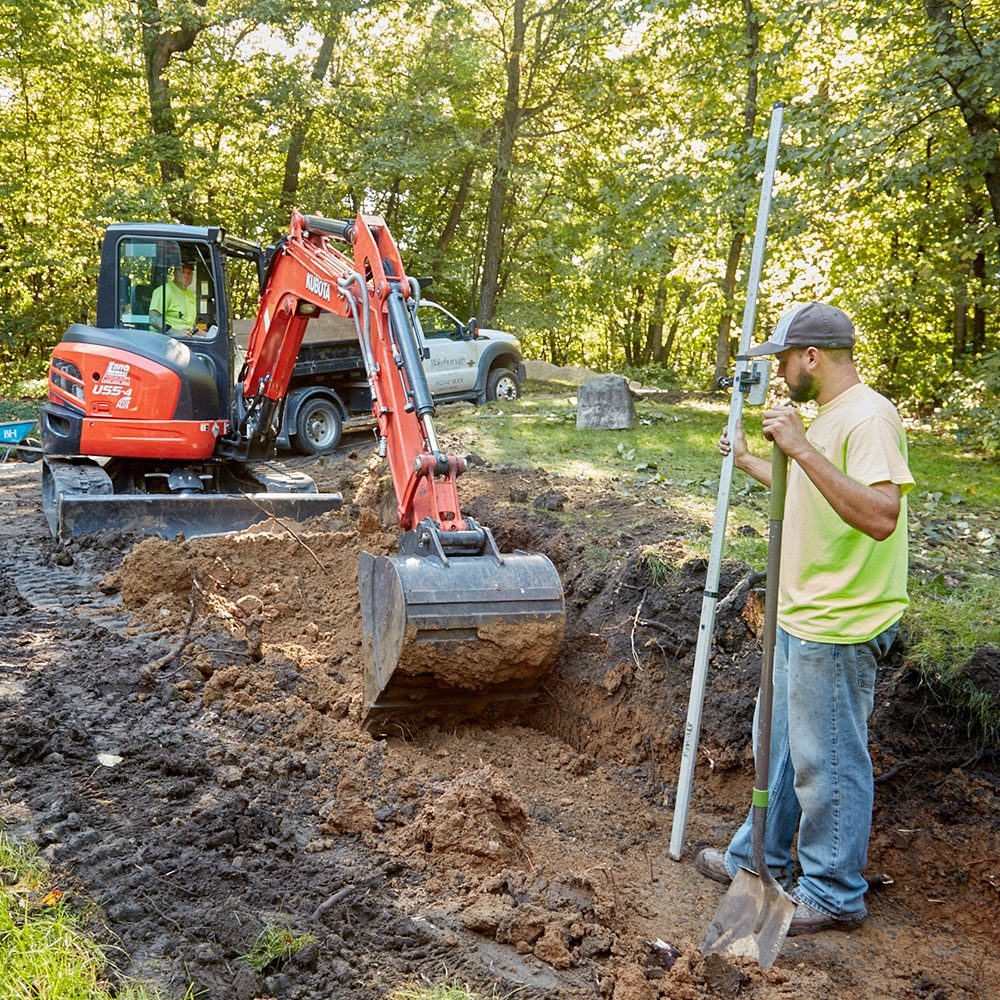 Digging a trench for a retaining wall | Construction Pro Tips