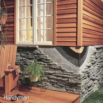 cutaway of a home with a faux stone facade