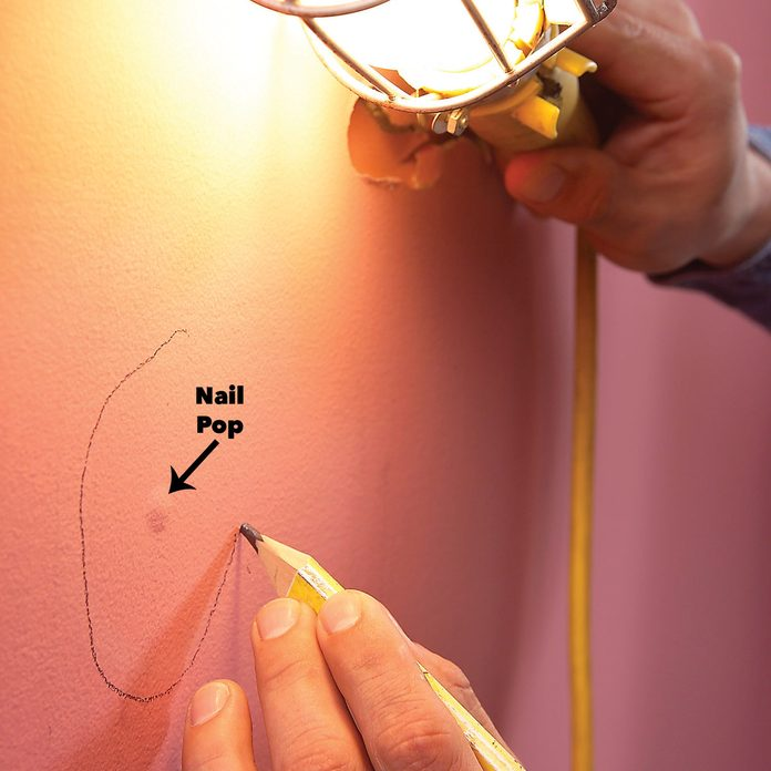 find flaws in wall with utility light nail pop