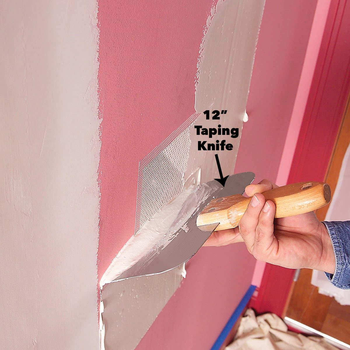 apply drywall compound over patch