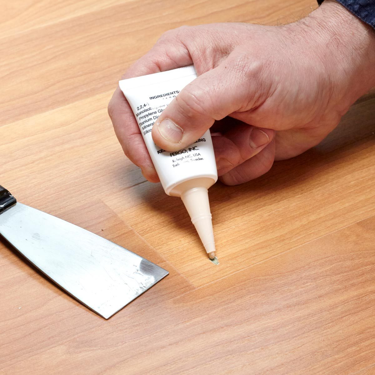 Repair minor damage in laminate flooring