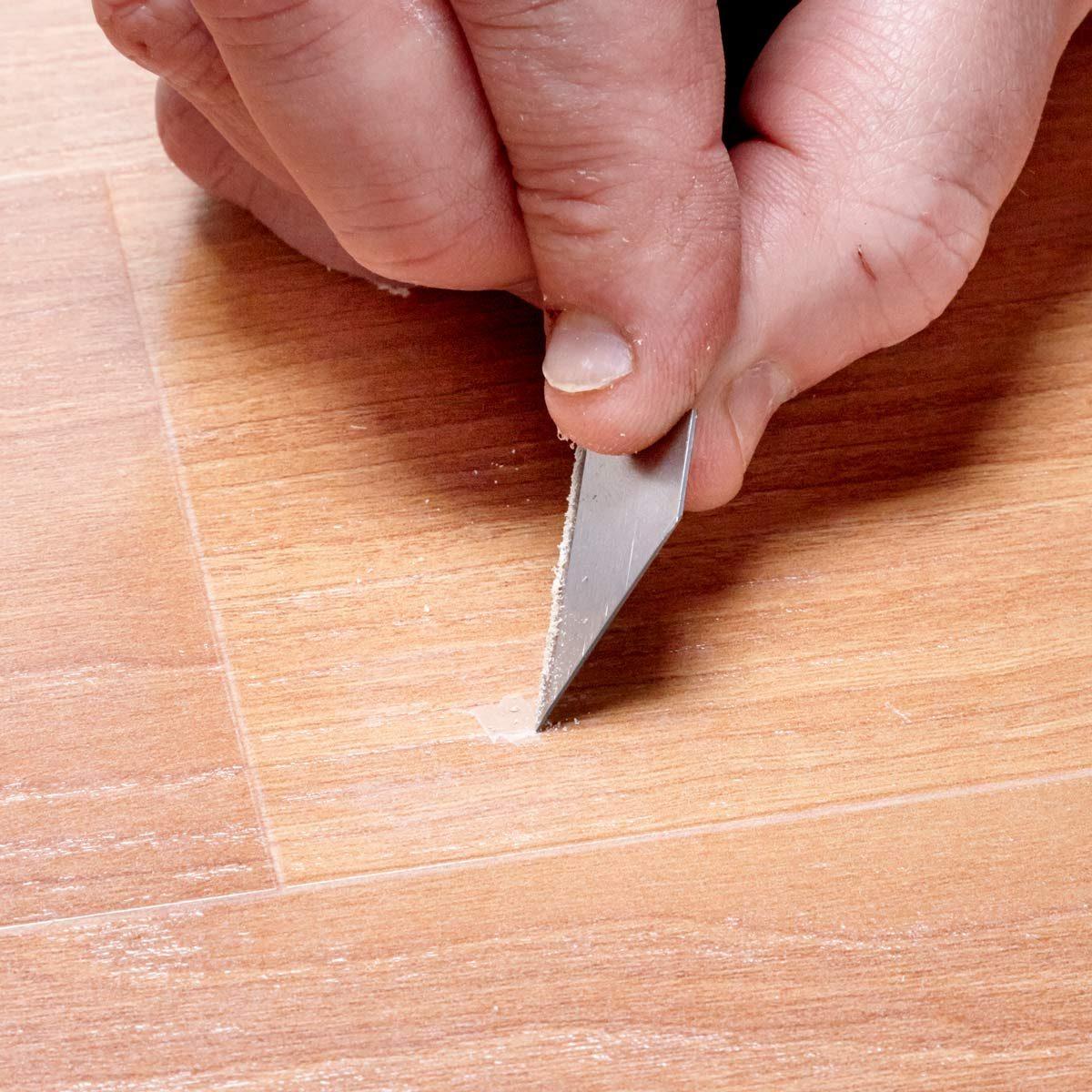 chipped laminate flooring