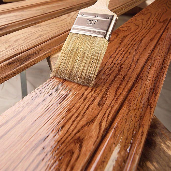 Applying long brush strokes on a length of trim | Construction Pro Tips