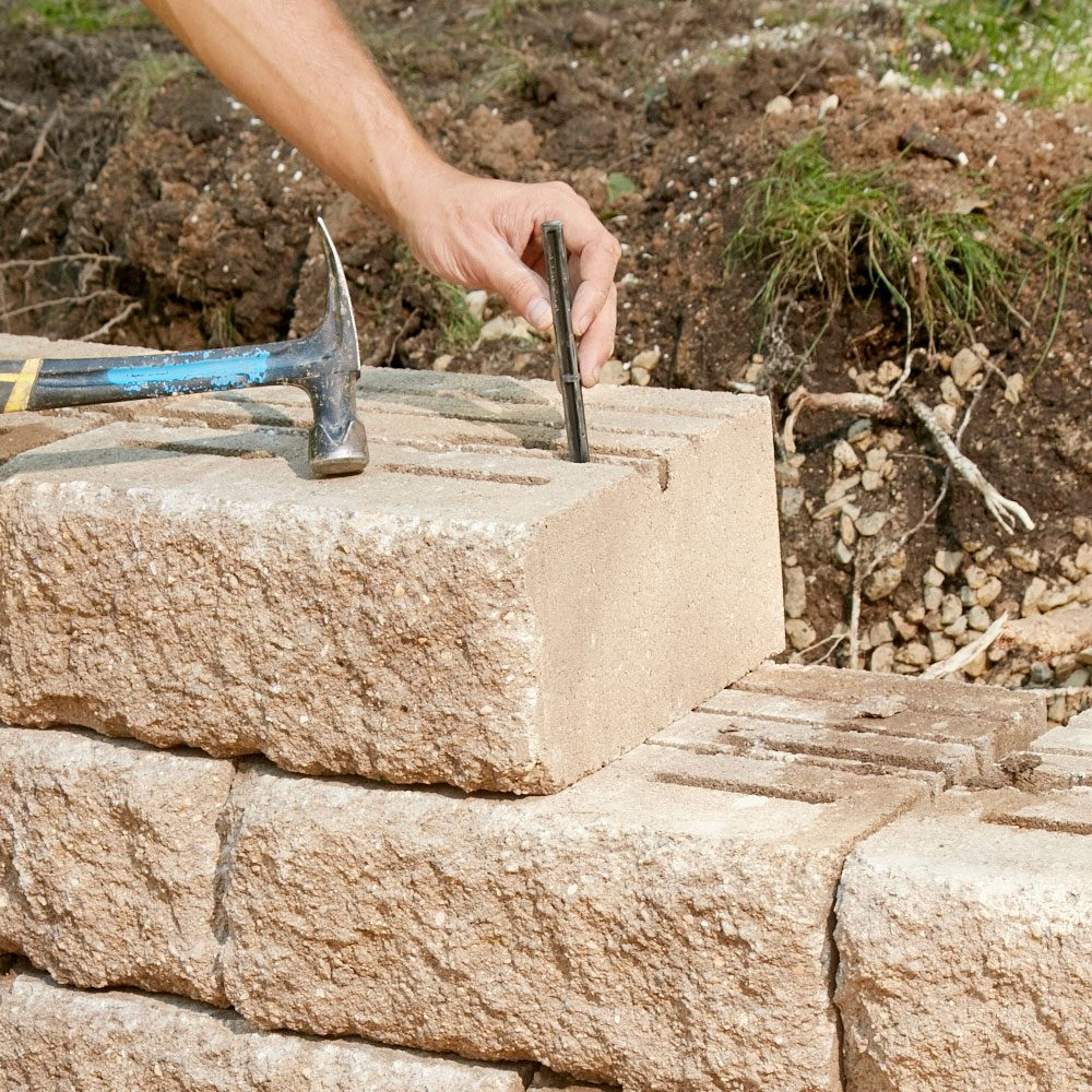 Adding a versa lock to a retaining wall block | Construction Pro Tips