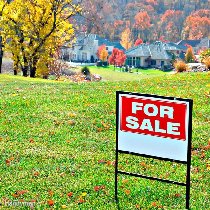 For sale sign house buying a home