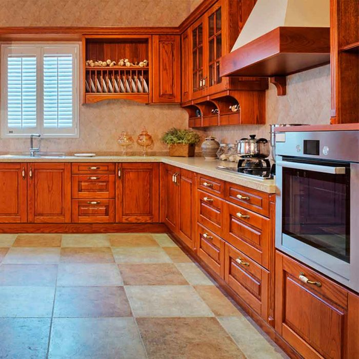 Strip Away Old Paint and Redo Your Cabinets