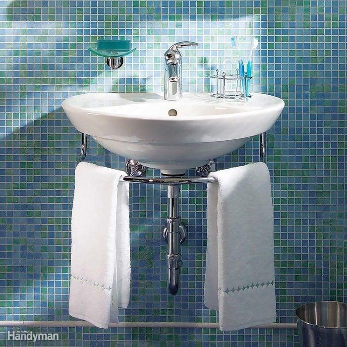 Space-saving wall-hung sink