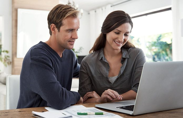 Two people looking at a computer screen | Construction Pro Tips