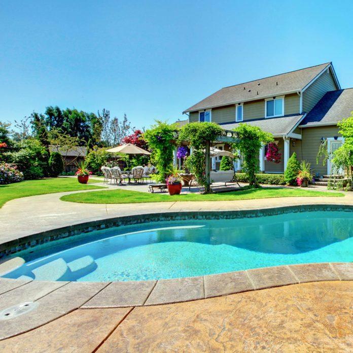 pool with vine pergola lush oasis