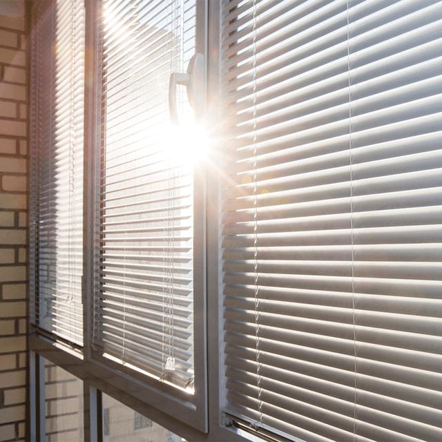 sun streaming through window blinds