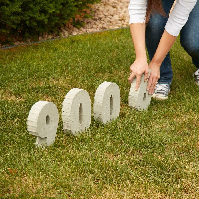 concrete house numbers placing in ground backyard wedding decorations