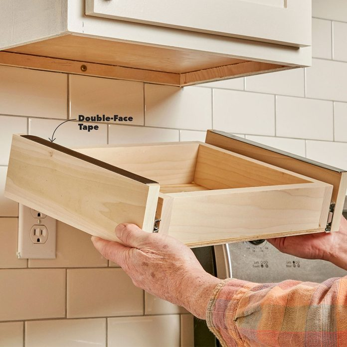 place under-cabinet drawer assembly on cabinet