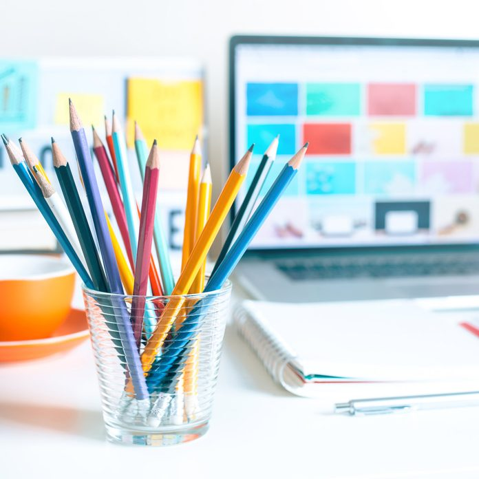 Close-Up Of Colored Pencils And Laptop On Table office Gettyimages 1196203348