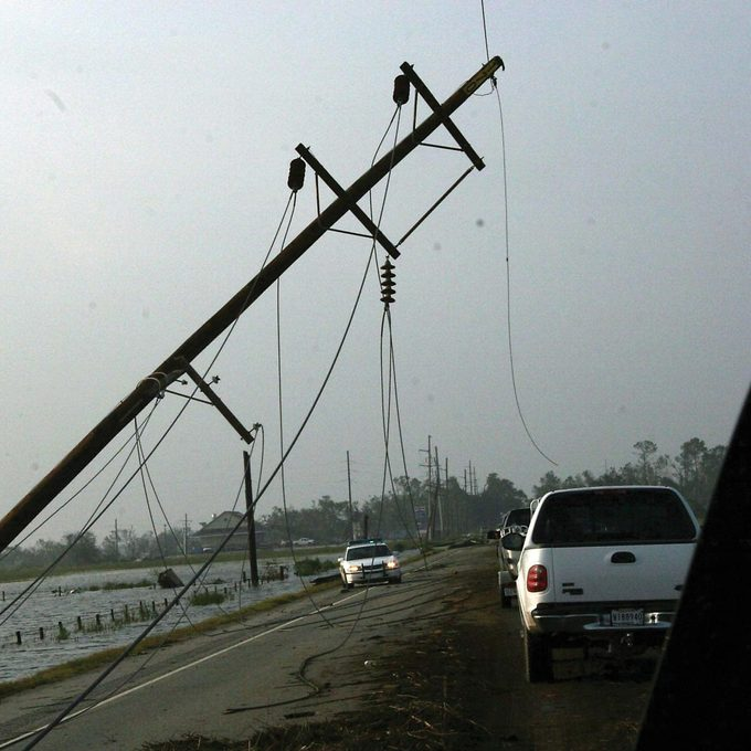 water and electricity don't mix cars and tipped over power line