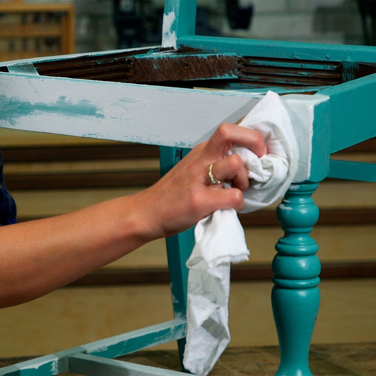 paint second layer on chair and remove some to reveal aged look