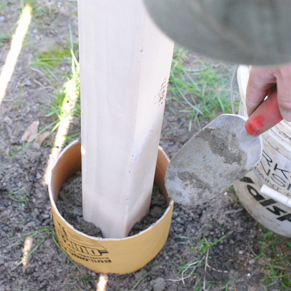 Fill tube with cement and insert post birdhouse pole