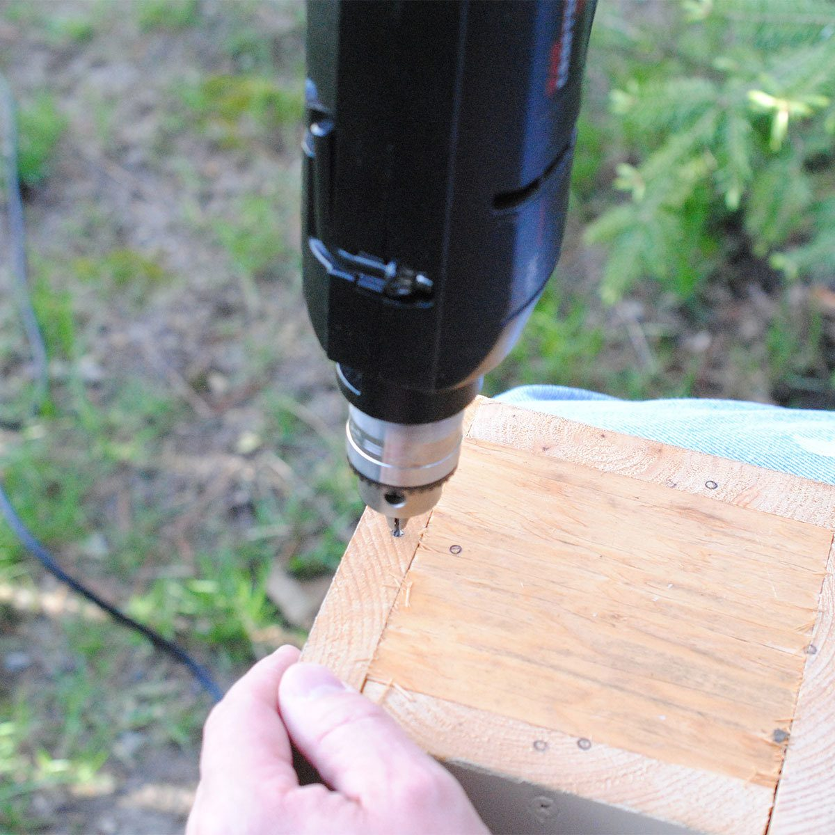 Drill holes into the birdhouse