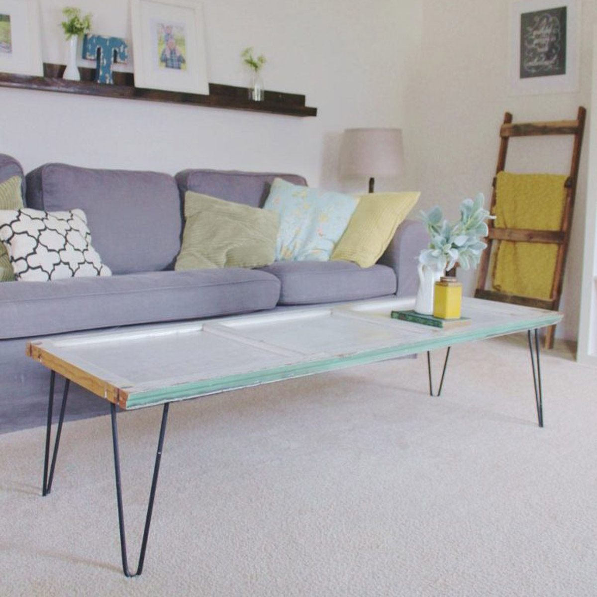 DIY coffee table with salvaged door and hairpin legs