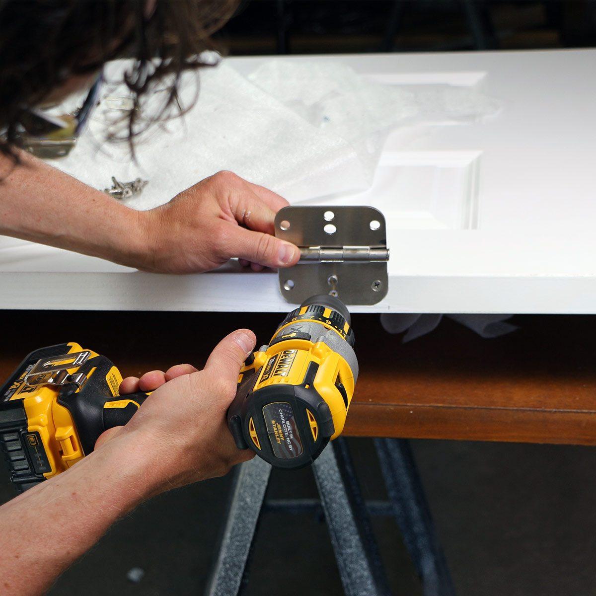 screw hinges to new door