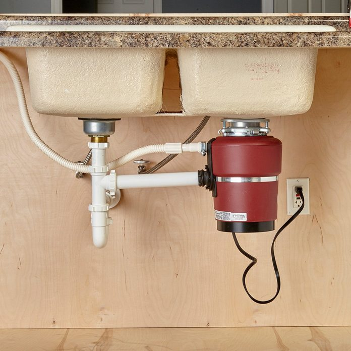 Garbage disposal under the sink   Construction Pro Tips