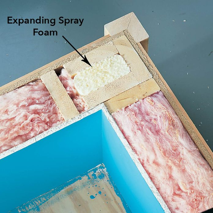 FH01FEB_02217007 expanding spray foam to prevent mold in uninsulated corner exterior wall space