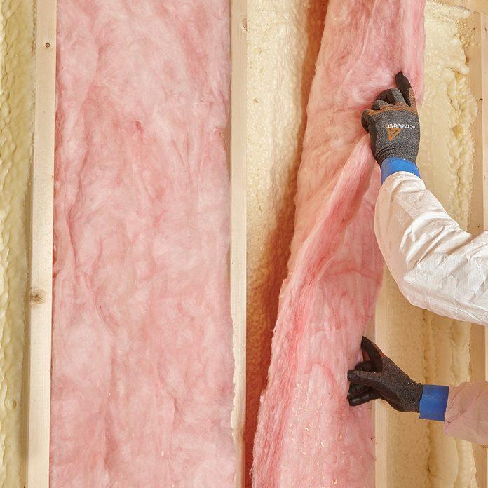 Laying fiberglass over spray foam   Construction Pro Tips