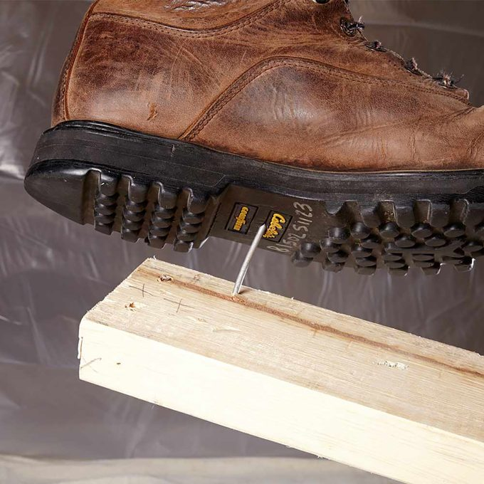 Nail poking up towards the exposed sole of a boot | Construction Pro Tips