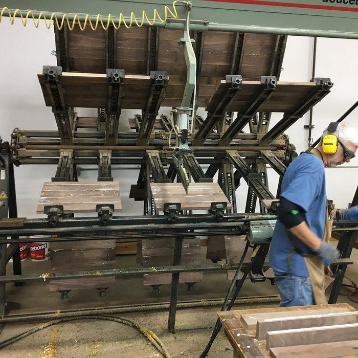 A machine gluing coffins | Construction Pro Tips