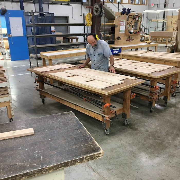Man making sure that the grains match | Construction Pro Tips
